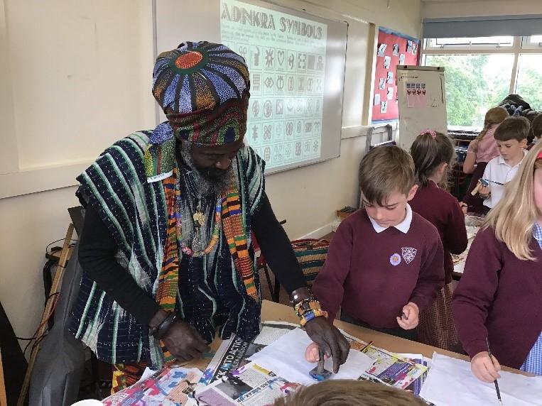 Kwame, Art workshop printing with Adinkra symbols.
