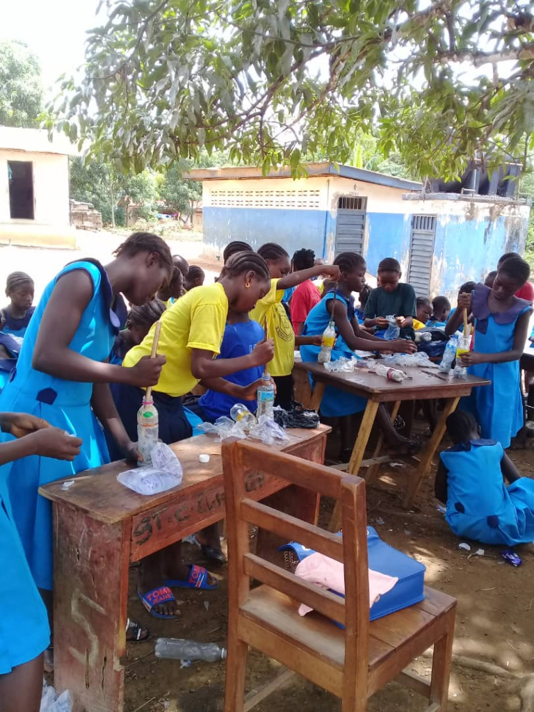 Pupils engaged in ecobrick making at St Charles Lwanga Primary in Bo